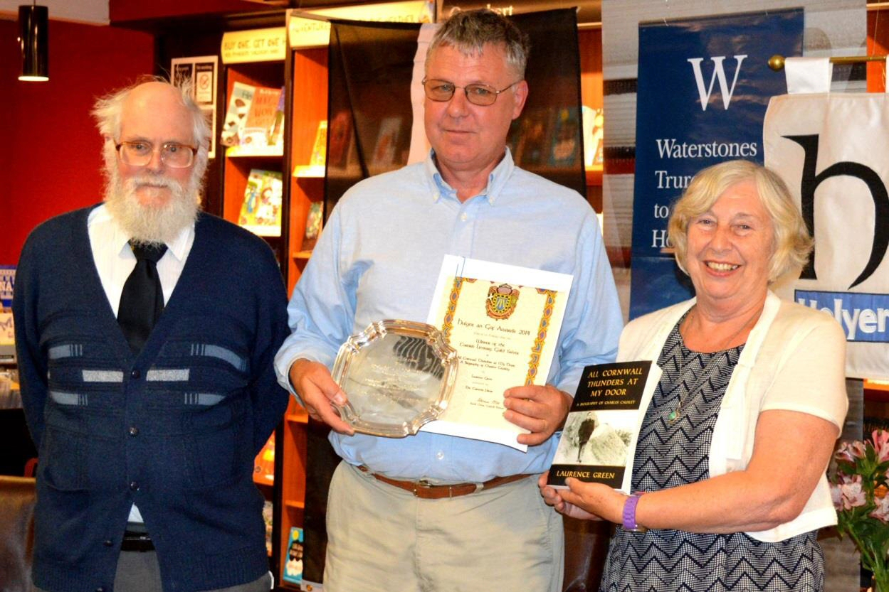 Donald Rawe, Chairman of the Cornish Literary Guild, and Marjorie James from same organisation present the Cornish Literary Guild Salver to Laurence Green for his biography of Charles Causley, All Cornwall Thunders at My Door, at the 2014 Holyer an Gof awards.